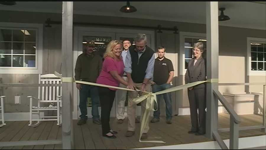 Nine months after a fire destroyed Jake's Market in Sunapee, the owner and staff celebrated the opening of a new building.