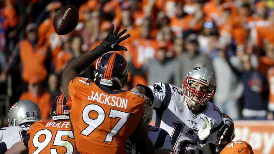 New England Patriots quarterback Tom Brady (12) passes as Denver Broncos defensive end Malik Jackson (97) tries to defend during the first half the NFL football AFC Championship game between the Denver Broncos and the New England Patriots, Sunday, Jan. 24, 2016, in Denver.