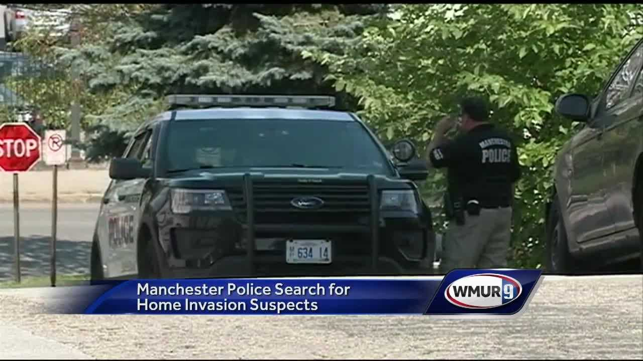 Police in Manchester said they are searching for two men who were involved in a daytime home invasion in which they fired guns and beat a man with a baseball bat.