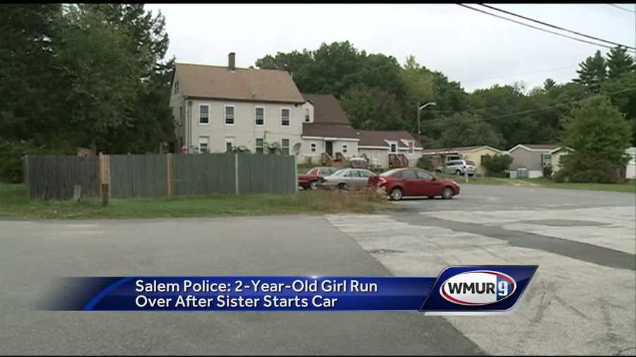 A Salem 2-year-old was hospitalized Tuesday after she was run over by a car with her 7-year-old sister in the driver's seat.