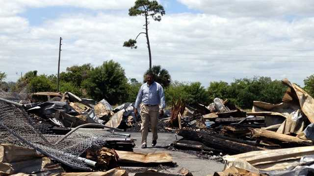 Pastor Jerome Rhyant at Love Center Ministries surveys the damage from the fire that destroyed the thrift store. (Cathleen O'Toole/WPBF)