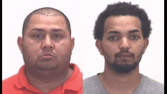 Police say Jose Flores and Eudys De Jesus were found with Halloween masks, a stolen gun and other weapons in their car.
