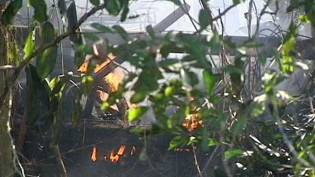 Firefighters spend more than an hour battling a blaze at a West Palm Beach mobile home.