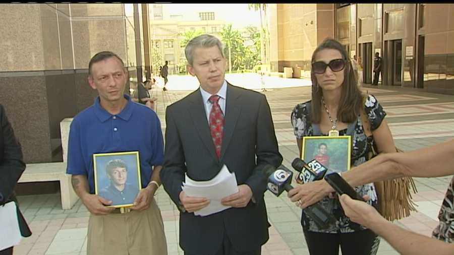 The parents of Michael Camberdella speak to the media after filing a wrongful-death lawsuit against the Palm Beach County Sheriff's Office.