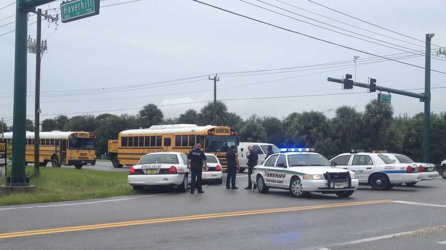 A school bus was caught in the crossfire at a Riviera Beach intersection Monday.