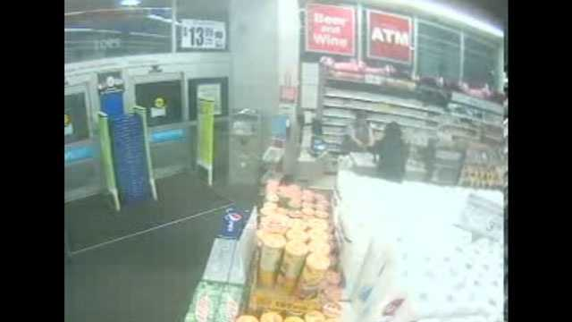 Police are trying to find a man who threatened to kill a Walgreens cashier during a robbery.