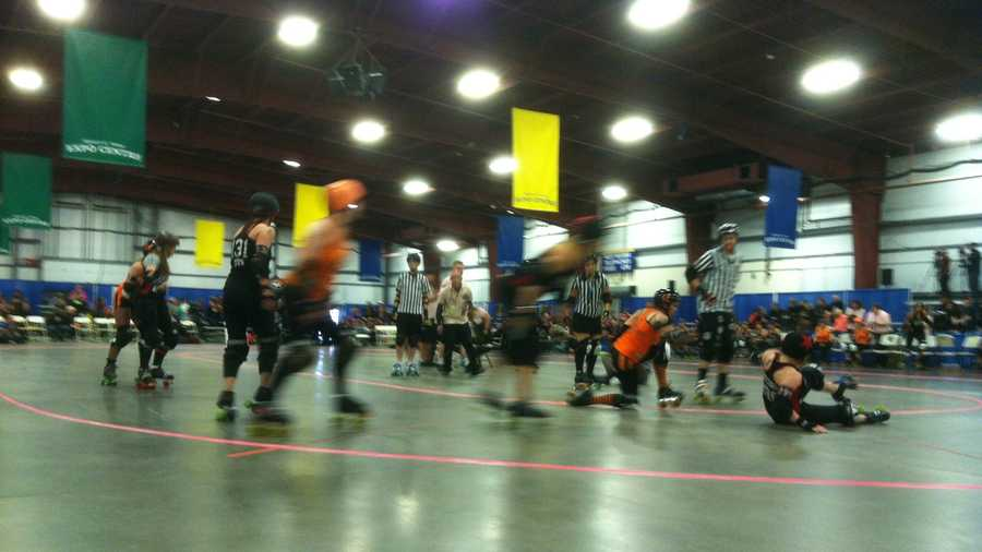 The jammer and the blockers face-off at the Roller Derby in Essex Junction Friday morning.