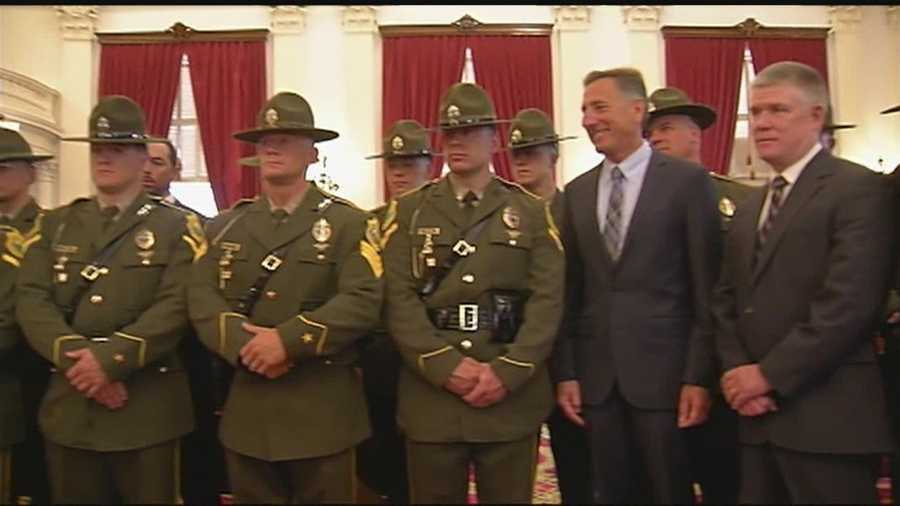 Members of the Vermont State Police Tactical Services Unit receive praise Thursday at a ceremony at the Statehouse in Montpelier.