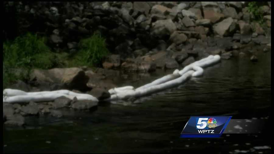 Environmental officials are continuing to clean up an oil spill days after it happened in Saranac Lake.