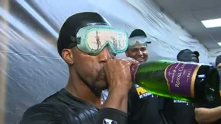 Andrew McCutchen takes a swig of sparkling wine in the locker room in Chicago as the Pirates celebrate the franchise's first playoff berth in 21 years.