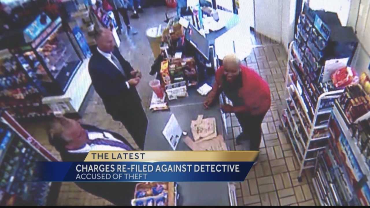 Surveillance video shows Pittsburgh Police Detective Michael Reddy removing an envelope with cash from the counter of a 7-Eleven store on the North Side.