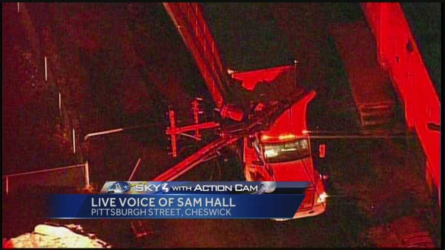 Pittsburgh's Action News 4's Sam Hall in Sky 4 over Pittsburgh Street in Cheswick where a driver is trapped in his tractor trailer after wires fall and the transformer catches on fire.