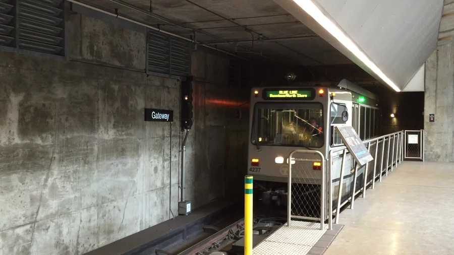The T approaches the platform at a Port Authority subway station.