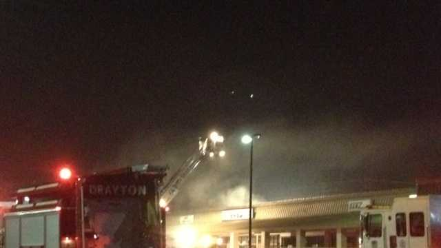 A fire broke out at the Poppy Square Shopping Center on McMillan Drive about 4:15 a.m. on Monday.