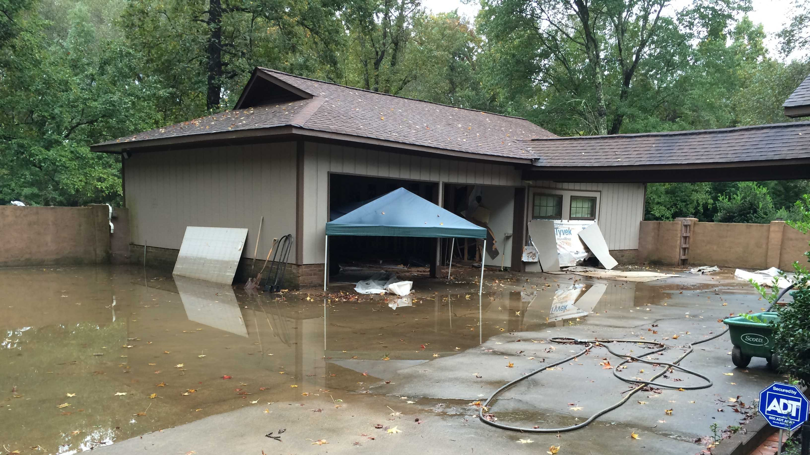 The Cantrells had a flood wall that held, but the water pressure built up, bursting through the garage and hitting their house.