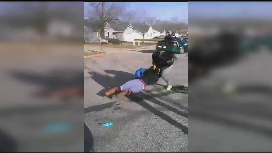 A Woodmont High School students was charged with assault and battery and threatening the life of an officer after someone videotaped a fight at a bus stop.