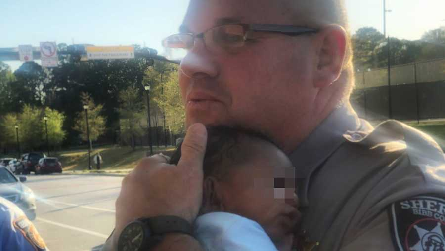 Photos of Bibb County Deputy Lee Rohrback comforting a child during a traffic stop have gone viral.