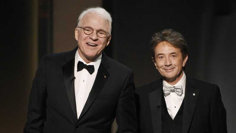 In this June 8, 2017 file photo, Steve Martin, left, and Martin Short appear at the 45th AFI Life Achievement Award Tribute to Diane Keaton in Los Angeles. Steve Martin and Martin Short are taking their touring act to television with a new Hulu comedy. The untitled show about three strangers who share an obsession with true crime and suddenly find themselves wrapped up in one was announced Friday, Jan. 17, 2020 at a TV critics meeting.