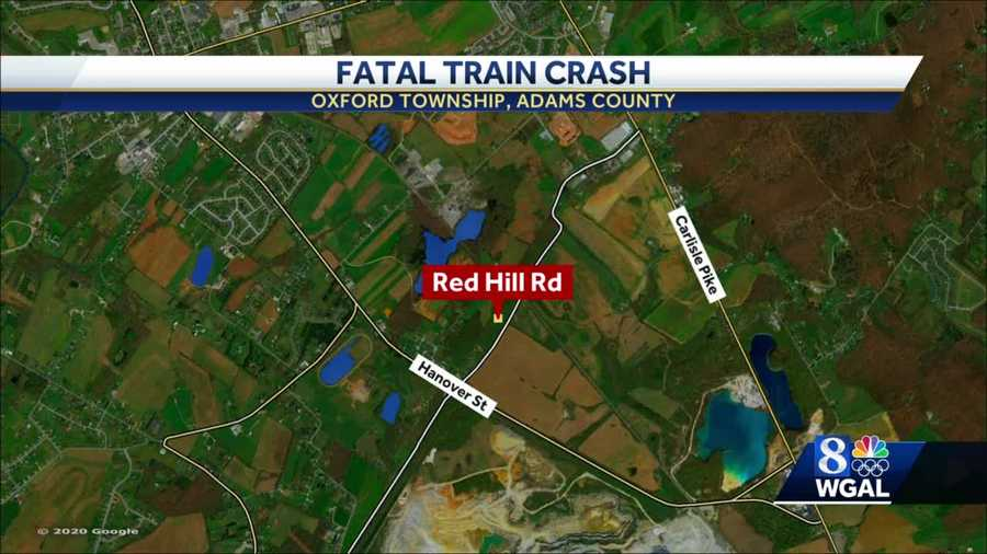 Police say a woman was killed when her car was hit by a train in Oxford Township, Adams County.