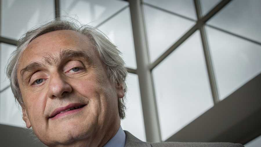 In this July 24, 2014, file photo, then-Chief Judge of the U.S. Court of Appeals for the Ninth Circuit Alex Kozinski poses for a portrait in the lobby of a Washington office building. Six women who served as clerks or externs at the U.S. 9th Circuit Court of Appeals allege to The Washington Post that judge Alex Kozinski subjected them to inappropriate sexual comments or conduct, including asking them to watch pornography in his chambers, the newspaper reported Friday, Dec. 8, 2017.