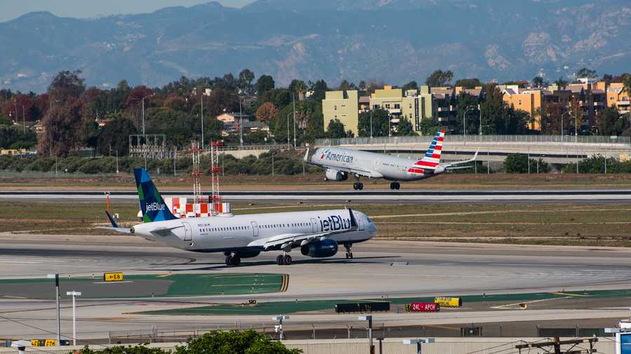 JetBlue and American Airlines are shown in this file photo.