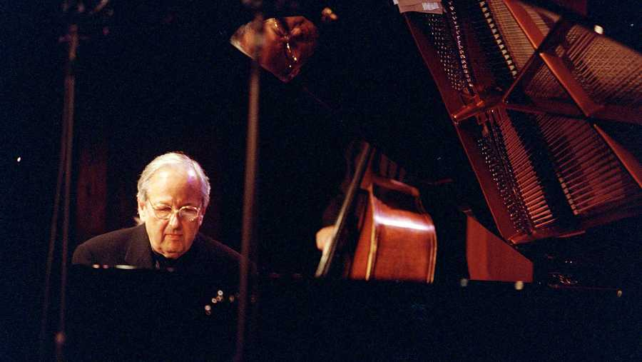 In this Oct. 15, 2000 file photo, conductor, composer and pianist Andre Previn performs at the Jazz Standard club in New York. Andre Previn's opera version of ``A Streetcar Named Desire'' finally made it to New York, 15 years after its world premiere. Previn's adaptation of the Tennessee Williams play, with a libretto by Philip Littell, returned on Thursday night, March 14, 2013, for a semi-staged concert performance at Carnegie Hall with Renee Fleming, who sang Blanche Dubois at the San Francisco Opera's world premiere production.
