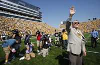 Former Iowa football coach Hayden Fry waves to the crowd as he is introduced before Iowa's NCAA college football game against Northern Iowa, Saturday, Sept. 5, 2009, in Iowa City, Iowa. Iowa won 17-16. (AP Photo/Charlie Neibergall)