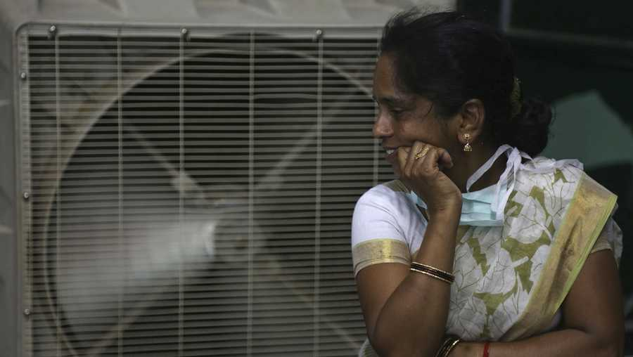 In this May 31, 2015 file photo, a woman cools herself on a hot summer day in Hyderabad, in the southern Indian state of Telangana. The U.N. weather agency said on Monday, Nov. 14, 2016, that 2016 is set to break the record for the hottest year since measurements began in the 19th century.