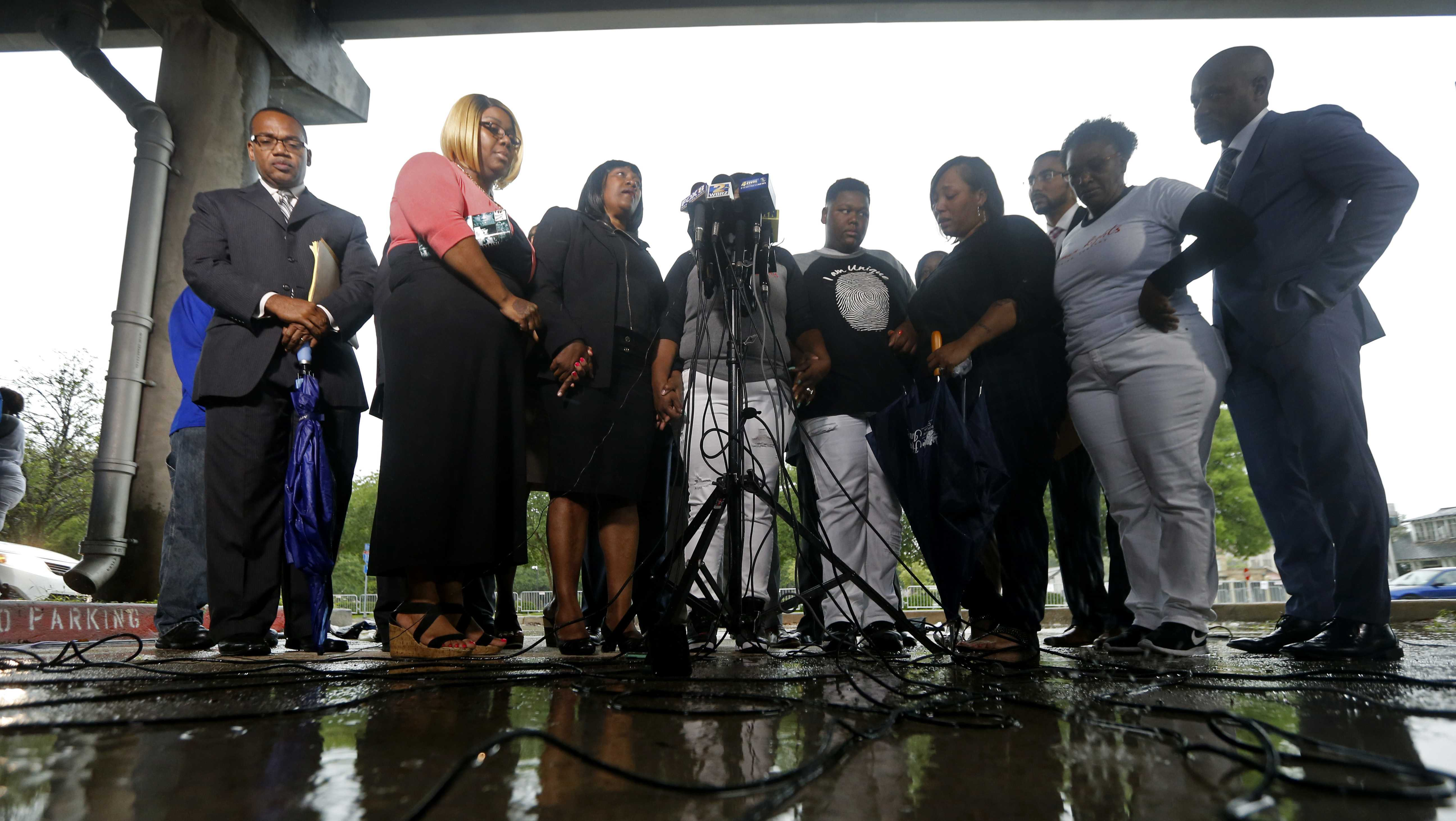 Family members of Alton Sterling and their attorneys speak after meeting with the U.S. Justice Department outside federal court in Baton Rouge, La., Wednesday, May 3, 2017. The Justice Department has decided not to charge two white Baton Rouge police officers in the shooting death of Sterling. (AP Photo/Gerald Herbert)