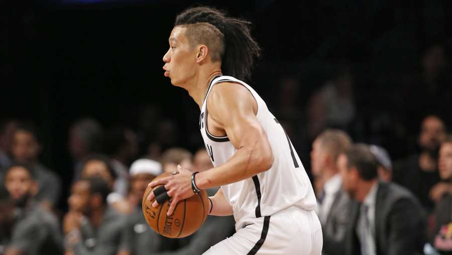 Brooklyn Nets guard Jeremy Lin looks to pass the ball during the first half of the team's preseason NBA basketball game against the Miami Heat, Thursday, Oct. 5, 2017, in New York. (AP Photo/Kathy Willens)