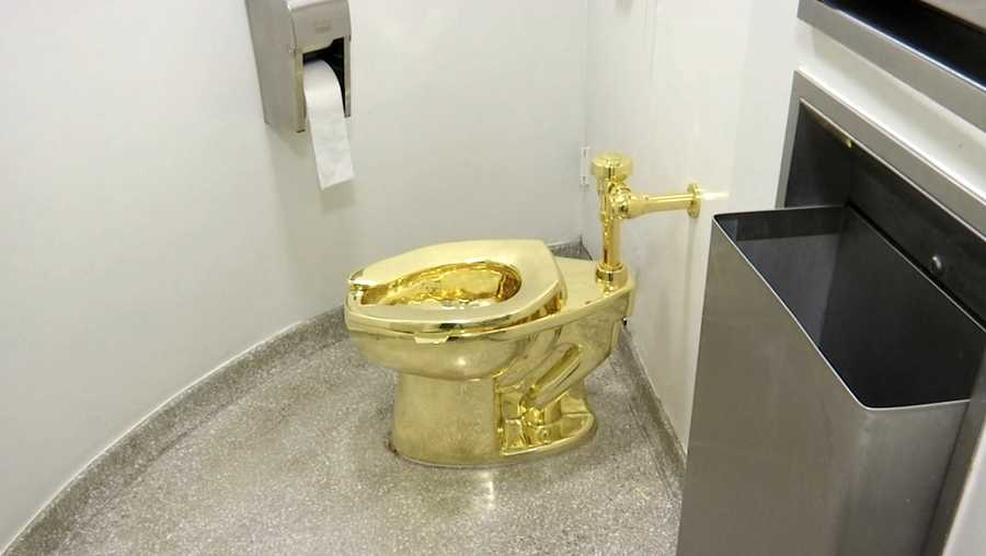 "This Sept. 16, 2016 image made from a video shows the 18-karat toilet, titled ""America,"" by Maurizio Cattelan in the restroom of the Solomon R. Guggenheim Museum in New York. According to a report in the Washington Post, President Donald Trump and first lady Melania asked the museum if they can borrow Van Gogh's painting entitled ""Landscape With Snow,"" for their private White House quarters. Instead, the Guggenheim Museum's chief curator came up with a pointedly satirical counter-offer. She offered them use of the solid gold toilet used by visitors in a museum restroom until last August."