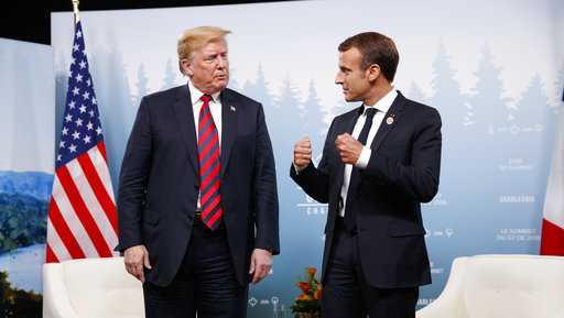 President Donald Trump meets with French President Emmanuel Macron during the G-7 summit, Friday, June 8, 2018, in Charlevoix, Canada.
