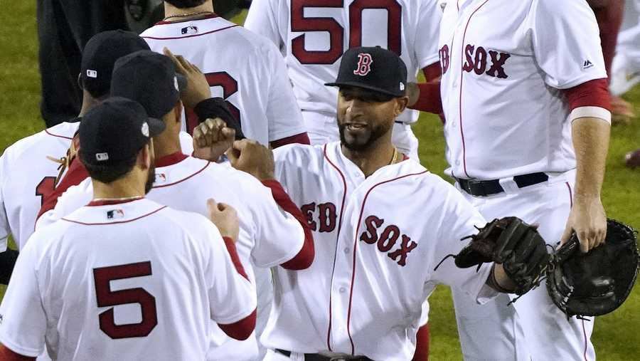 Boston Red Sox's Eduardo Nunez, right, celebrates after defeating the Los Angeles Dodgers 8-4 in of Game 1 of the World Series baseball game Tuesday, Oct. 23, 2018, in Boston.