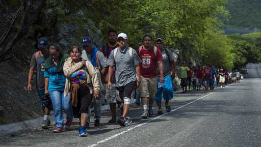 Honduras migrants walk to the U.S as they approach Zacapa, about 70 miles northeast of Guatemala City, Wednesday, Oct. 24, 2018. This new group of a few hundred Honduran migrants are behind the first group that has swelled to thousands and is currently traveling through Mexico.