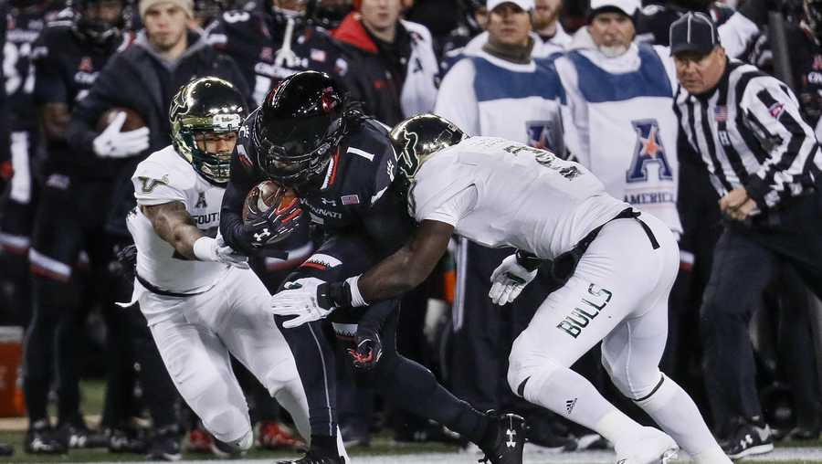 Cincinnati wide receiver Kahlil Lewis (1) runs the ball against South Florida linebacker Khalid McGee (2) during the first half of an NCAA college football game, Saturday, Nov. 10, 2018, in Cincinnati. (AP Photo/John Minchillo)