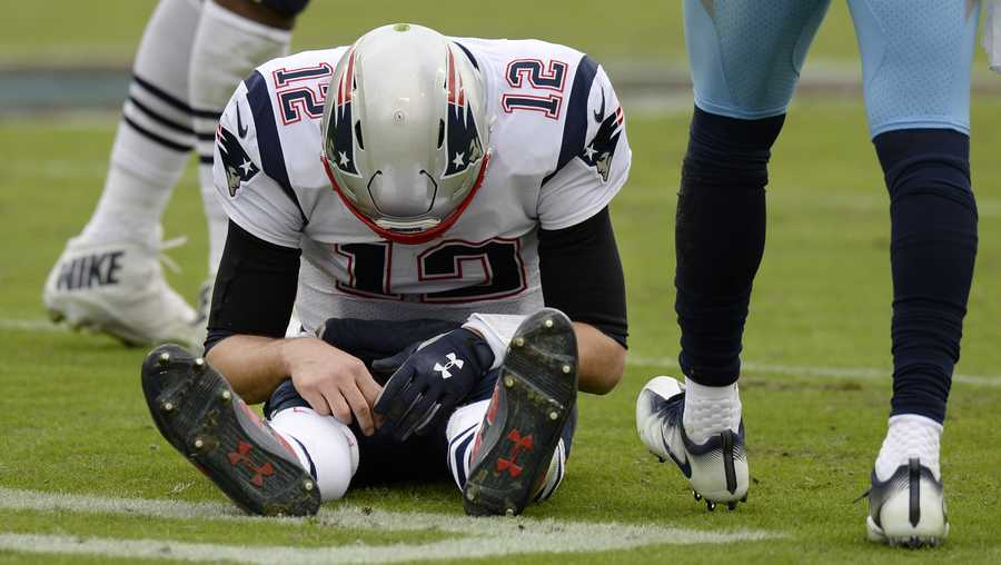 New England Patriots quarterback Tom Brady (12) sits on the turf after being sacked by the Tennessee Titans in the second half of an NFL football game Sunday, Nov. 11, 2018, in Nashville, Tenn. (AP Photo/Mark Zaleski)