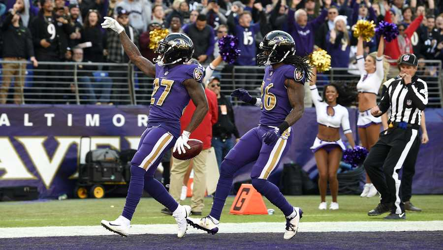 Baltimore Ravens punt returner Cyrus Jones, left, celebrates his touchdown with teammate Maurice Canady in the first half of an NFL football game against the Oakland Raiders, Sunday, Nov. 25, 2018, in Baltimore. (AP Photo/Nick Wass)