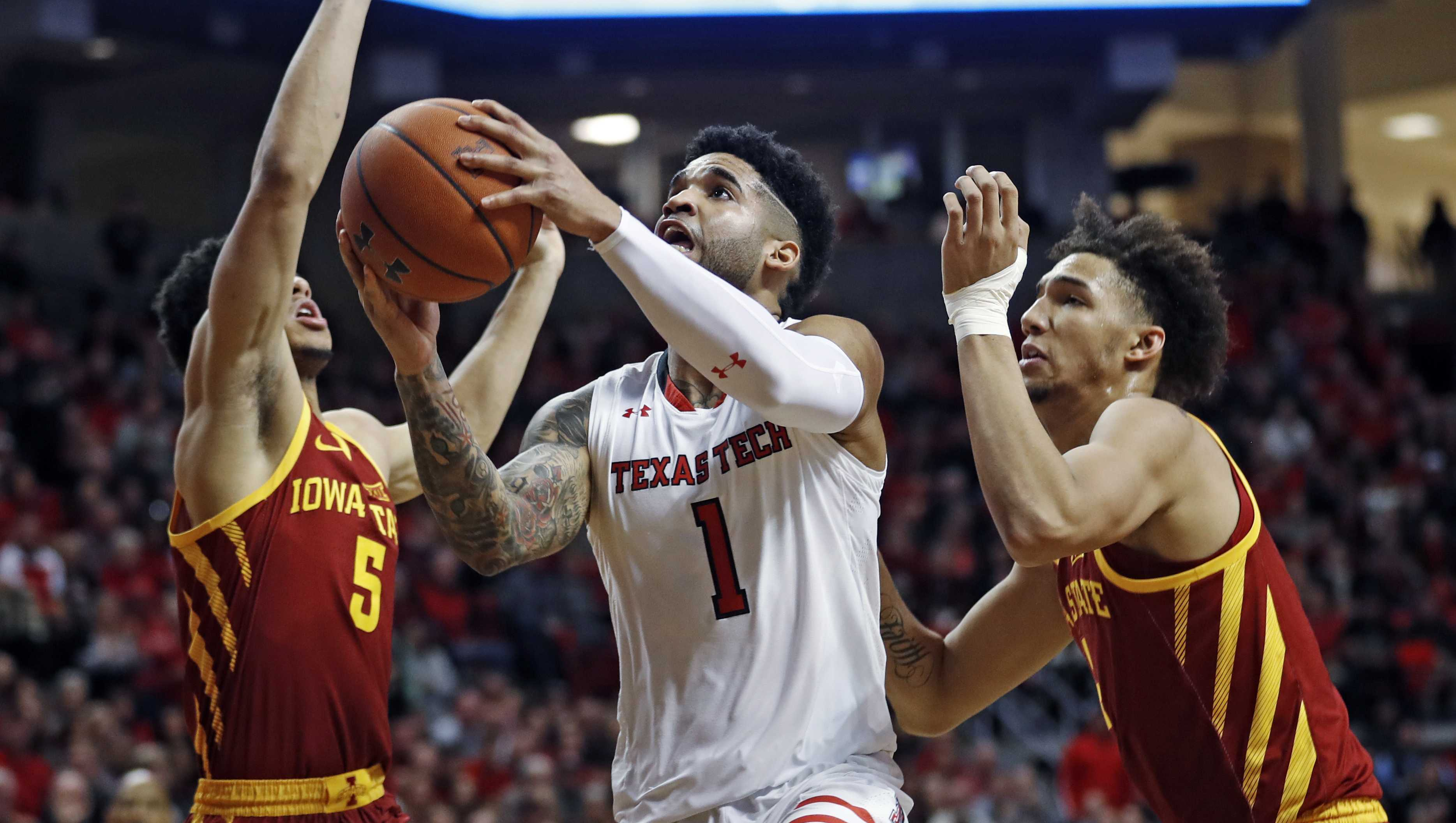 Texas Tech's Brandone Francis (1) goes to the basket between Iowa State's Lindell Wigginton (5) and George Conditt IV during the first half of an NCAA college basketball game Wednesday, Jan. 16, 2019, in Lubbock, Texas. (AP Photo/Brad Tollefson)