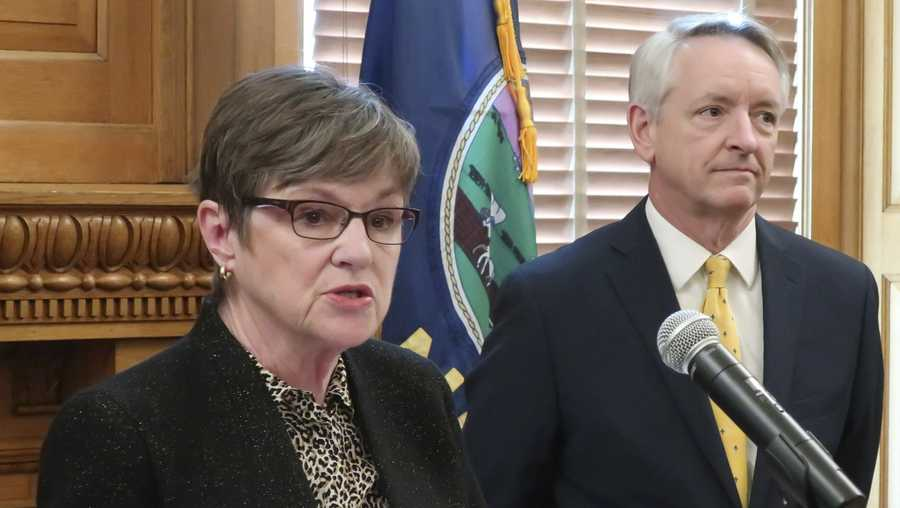 Kansas Gov. Laura Kelly, left, introduces Jeffry Jack, right, as her nominee for a seat on the state Court of Appeals, during a news conference, Friday, March 15, 2019, at the Statehouse in Topeka.
