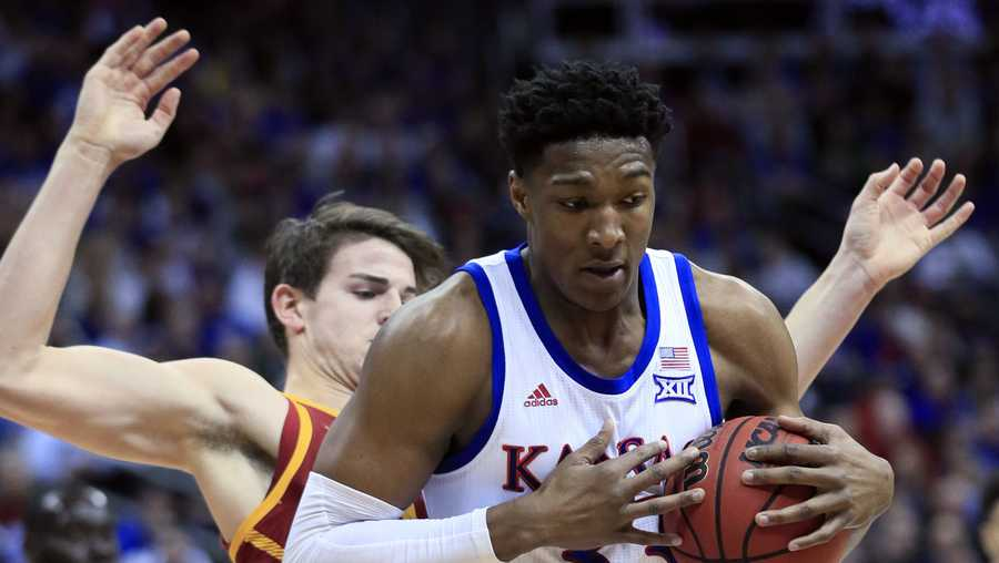 Kansas forward David McCormack (33) backs into Iowa State forward Michael Jacobson during the first half of an NCAA college basketball game in the finals of the Big 12 men's tournament.