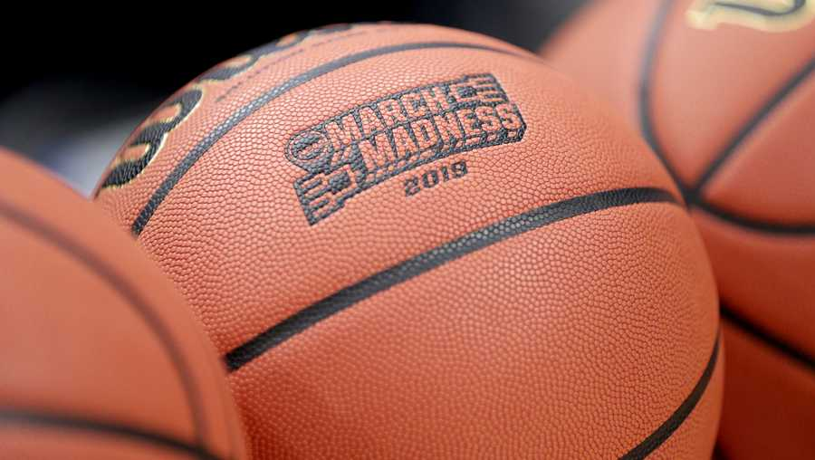 "FILE - This Wednesday, March 20, 2019, file photo shows a basketball with March Madness 2019 in a rack before Michigan practice at the NCAA college basketball tournament in Des Moines, Iowa. An Ohio man has made history with a March Madness bracket that's perfect through 48 games on the NCAA.com's ""Bracket Challenge,"" according to the NCAA. (AP Photo/Nati Harnik, File)"