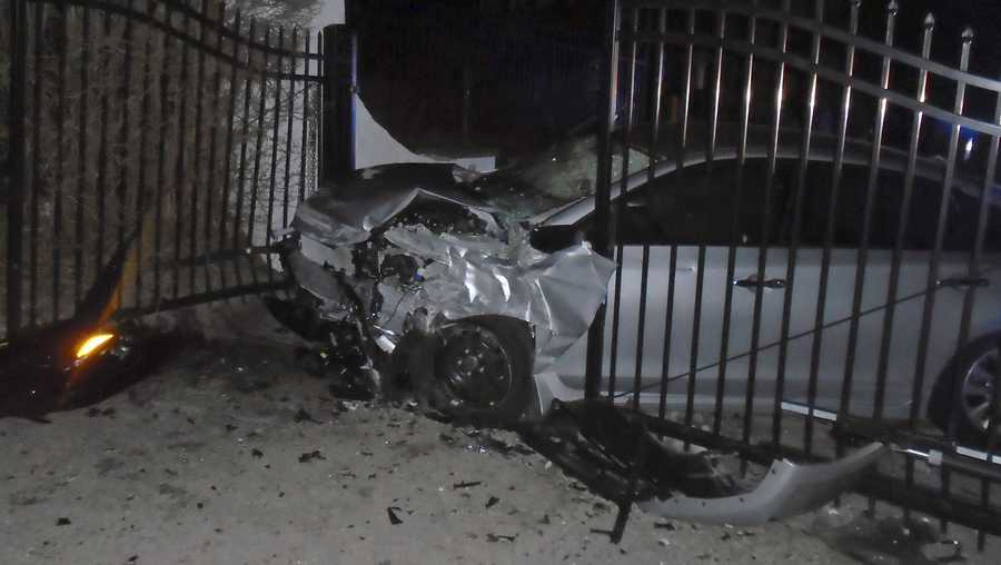 This Tuesday, April 2, 2019 photo released by the Hopkinton, R.I., Police Department shows a car after it crashed into the gates of singer Taylor Swift's beachfront home in Westerly, R.I. Police said the car was stolen in Hartford, Conn., and that officers from Hopkinton and Westerly pursued the vehicle with four occupants around 1 a.m. Tuesday. (Hopkinton Police Department via AP)