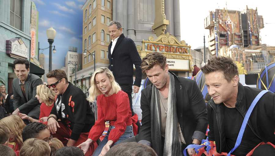 """Avengers: Endgame"" cast member, Paul Rudd, foreground from left, Scarlett Johansson, Robert Downey Jr., Brie Larson, Chris Hemsworth and Jeremy Renner appear with Disney CEO, Robert Iger,, background center, at an event announcing the Universe Unites Charity at Disney California Adventure Park on Friday, April 5, 2019, in Anaheim, Calif."