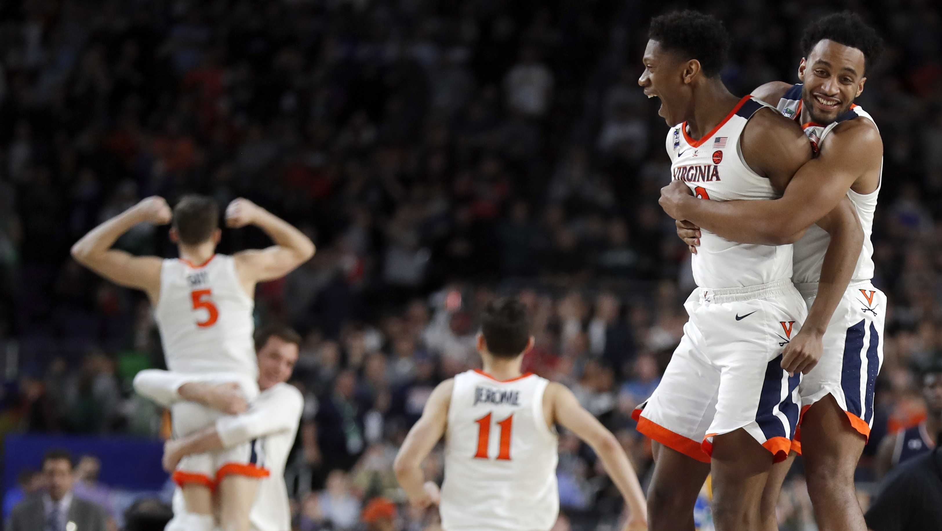 Virginia players celebrate after defeating Auburn 63-62 in the semifinals of the Final Four NCAA college basketball tournament, Saturday, April 6, 2019, in Minneapolis.