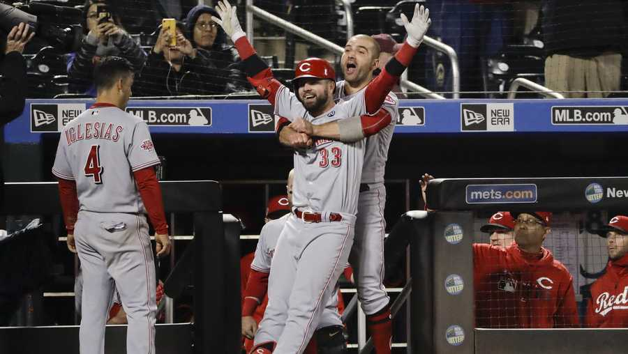 Cincinnati Reds' Jesse Winker (33) celebrates with teammates Joey Votto, right, and Jose Iglesias, left, after hitting a home run during the ninth inning of a baseball game against the New York Mets Monday, April 29, 2019, in New York. (AP Photo/Frank Franklin II)