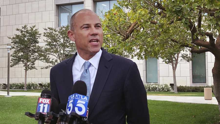 Attorney Michael Avenatti talks to the media outside of federal court in Santa Ana, Calif. on Wednesday, May 15, 2019. Avenatti has told a federal judge in California that he has hired a lawyer to represent him in a case alleging he stole millions of dollars from clients, cheated on taxes and committed bank fraud.