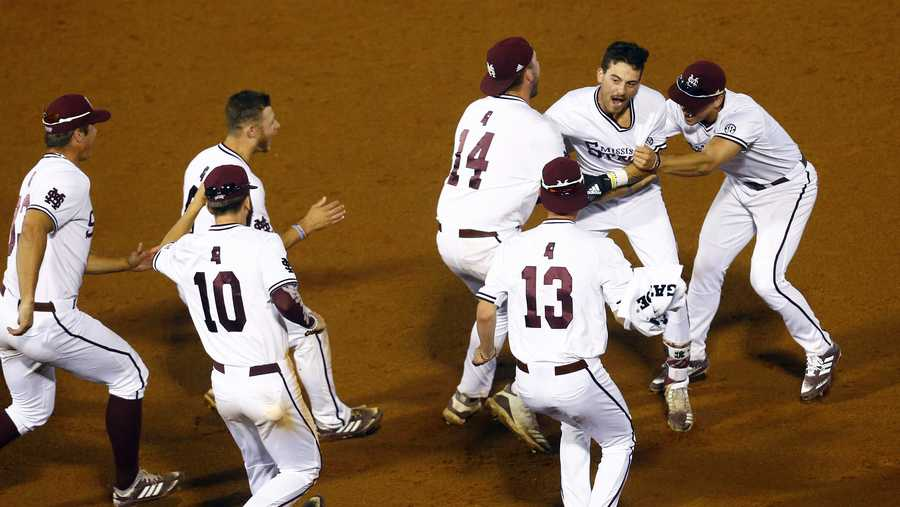 Mississippi State's Gunner Halter (2) celebrates with teammates after driving in the winning run during the 17th inning of the Southeastern Conference tournament NCAA college baseball game against LSU, early morning Thursday, May 23, 2019, in Hoover, Ala. State defeated LSU 6-5. (AP Photo/Butch Dill)