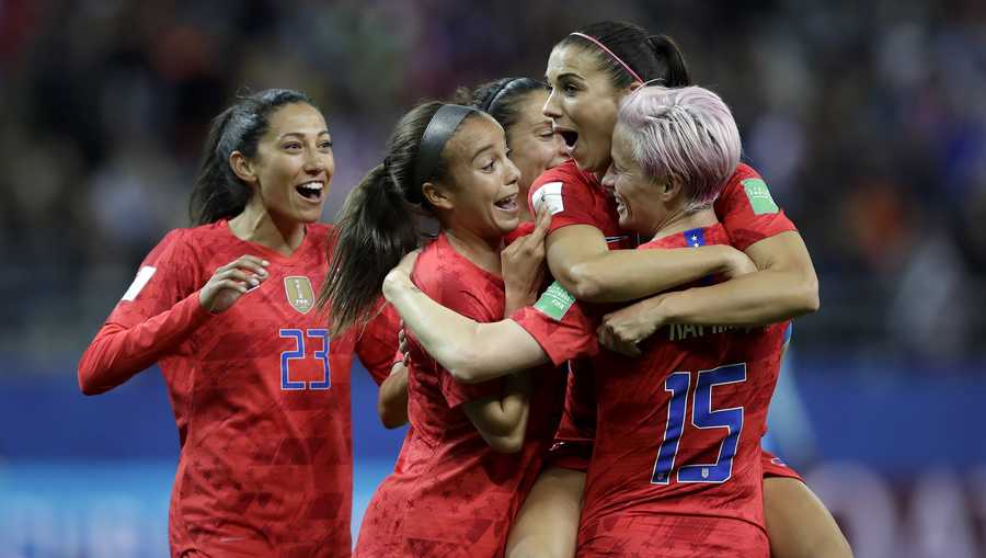 United States' Alex Morgan, second right, celebrates after scoring her side's 12th goal during the Women's World Cup Group F soccer match between United States and Thailand at the Stade Auguste-Delaune in Reims, France, Tuesday, June 11, 2019. Morgan scored five goals during the match.