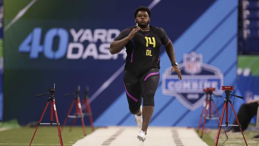 "FILE - In this March 4, 2018 file photo, Miami defensive lineman Kendrick Norton runs the 40-yard dash at the NFL football scouting combine in Indianapolis.  The Dolphins say Norton suffered injuries in a ""serious"" car crash. The team said in a statement Thursday, July 4, 2019,  that 22-year-old Norton's injuries aren't considered life-threatening, but offered few other details. The crash happened late Thursday near Miami.(AP Photo/Michael Conroy, File)"