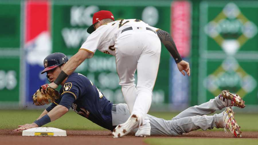 Milwaukee Brewers' Christian Yelich is tagged out by Pittsburgh Pirates shortstop Kevin Newman as he tried to steal second during the first inning of a baseball game Saturday, July 6, 2019, in Pittsburgh. (AP Photo/Keith Srakocic)